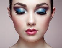 彩妆美女脸部特写摄影图片