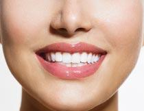 健康牙齿的笑容美女特写摄影图片