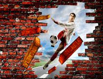 足球运动员与砖头横飞的墙影楼背景