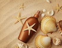 防晒霜与沙滩贝壳海星海螺摄影图片