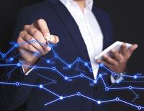 蓝色折线与人物的手势创意图片