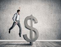 美元符号与跳起的男人高清图片